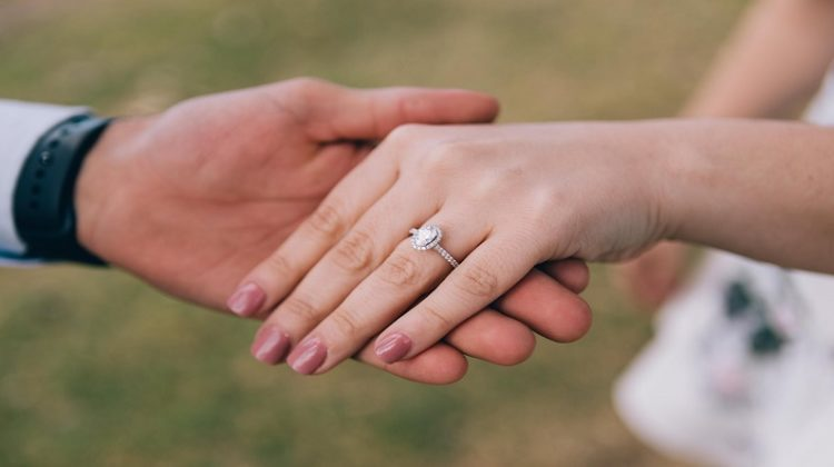 Couples Hands Showing Engagement Ring - The Perfect Engagement Ring
