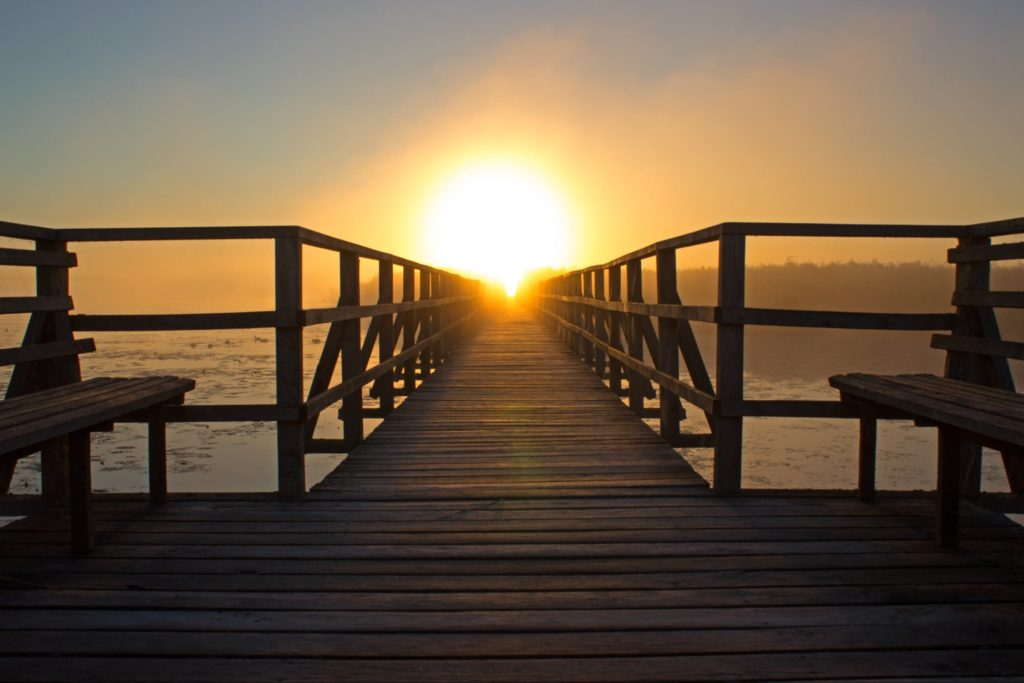 Dock over water at sunset - Cultivate Better Habits