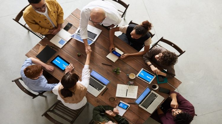 Office Staff Around Table with Laptops - Make Your Organization More Innovative