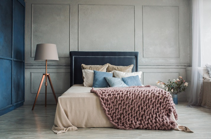 Bedroom with Large bed with lots of pillows - Turning Your Bedroom Into a Sleep Haven