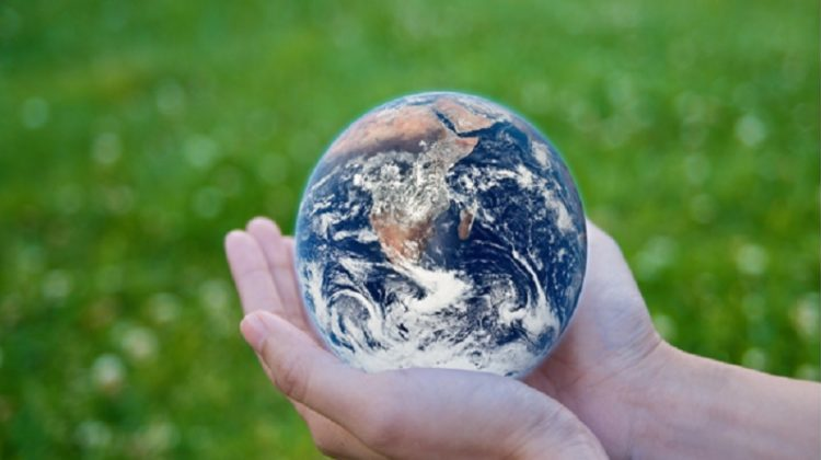 Globe in outstretched hands.- Climate Change