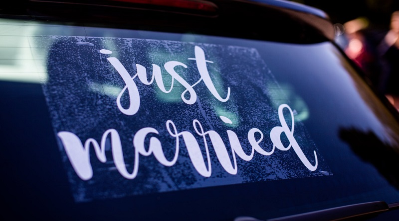 Just Married Sign in Car Window - Romantic Honeymoon In a Foreign Country