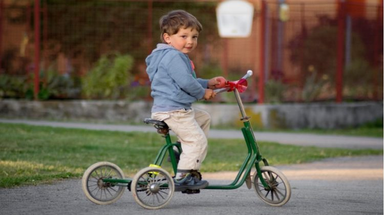 Little boy on green tricycle - Toys For 3-Year-Old Boys