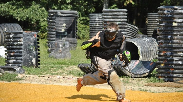 Paintballer running across course - Paintball Guns
