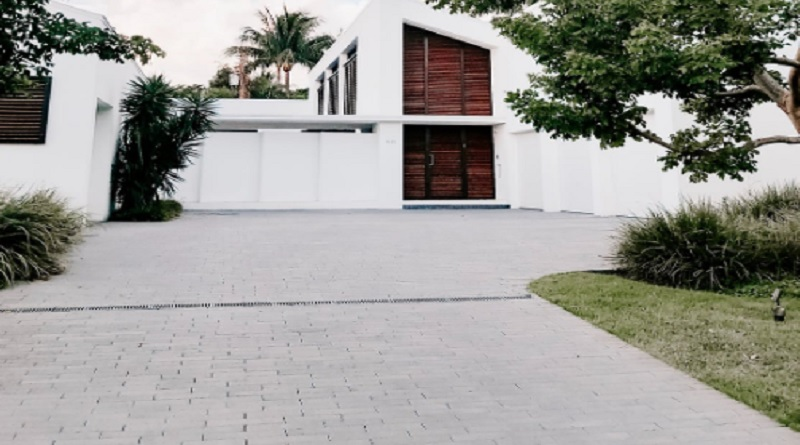 Modern Home with White Paver Driveway - Paver Maintenance Tips