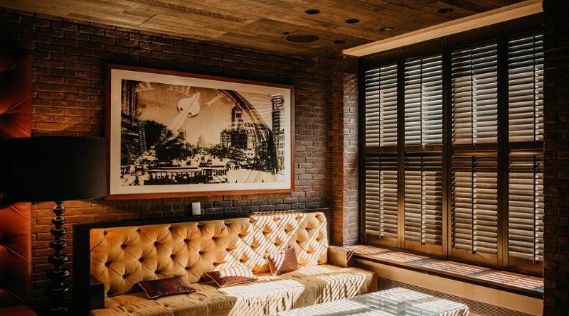 Framed art hanging on brick wall in living room - Customized Artwork