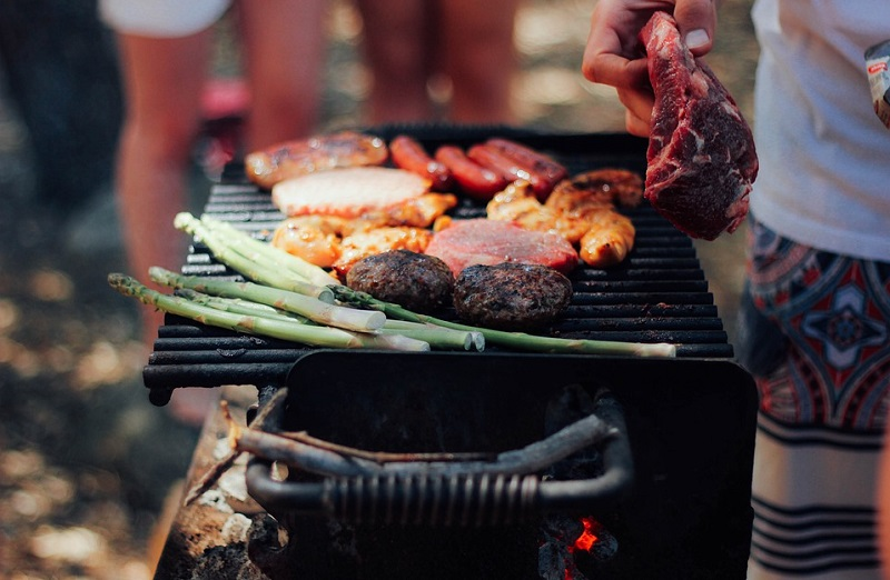 BBQ Grill with vegetables, meat, and chicken - De-Winterize your Yard