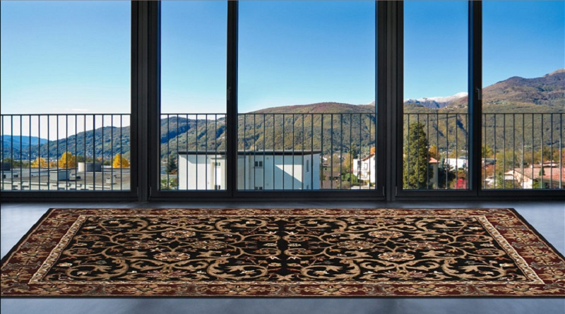 Large Area Rug on Floor in room with large windows over looking hills. - rug purchasing guide