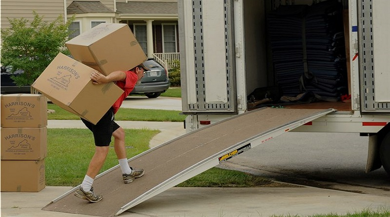 Mover carrying boxes into moving van -Your Home? 7 Things You Must Check Out