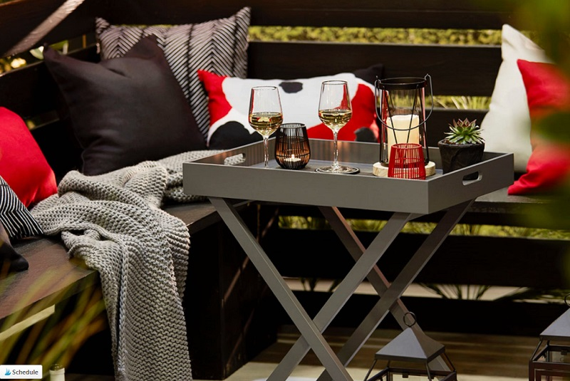 Folding Butlers Table with Wine Glasses and a Lantern on Patio - Creating A Perfect Patio Area