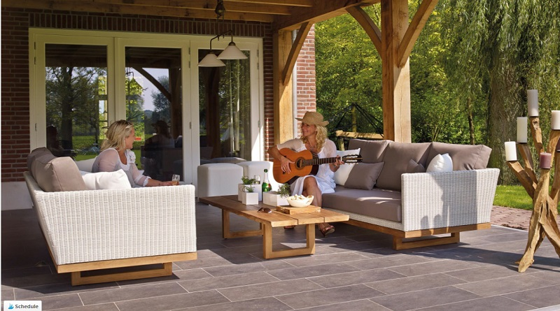 Two women on a patio - Creating A Perfect Patio Area