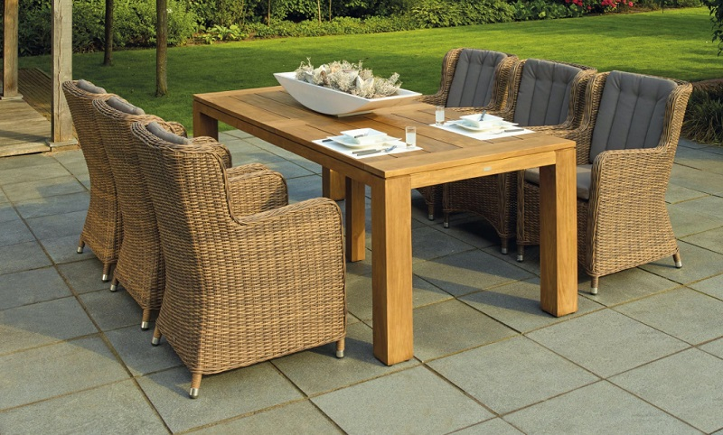Light Wood Table with Upholsterer Rattan Chairs on Open Patio - Is Your Home Summer-Ready