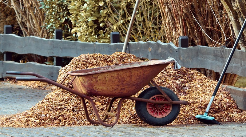 Wheelbarrow and mulch pile - Get Rid of Yard Waste