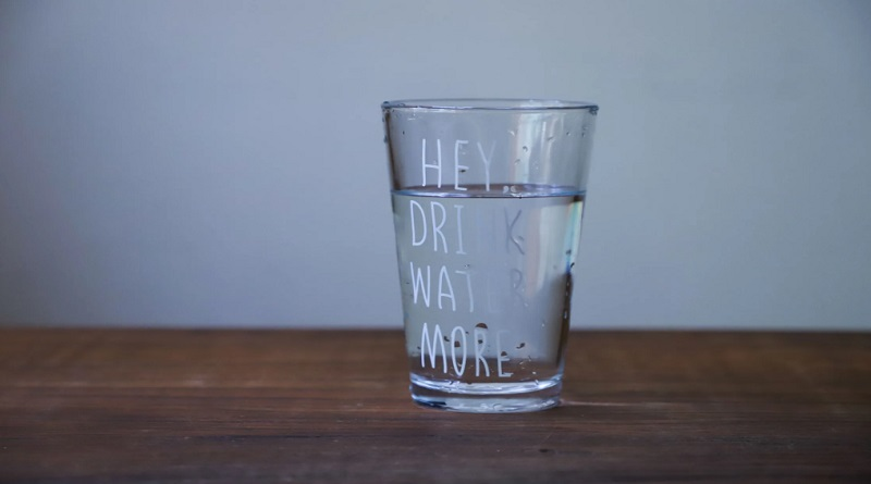 Drink Water More Glass on Wood Table - Benefits of Drinking More Water