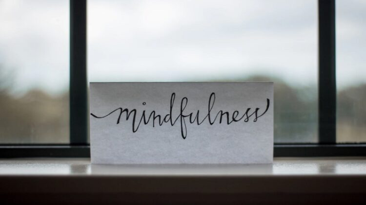 Mindfulness sign on windowsill - Begin a Self-Improvement Project