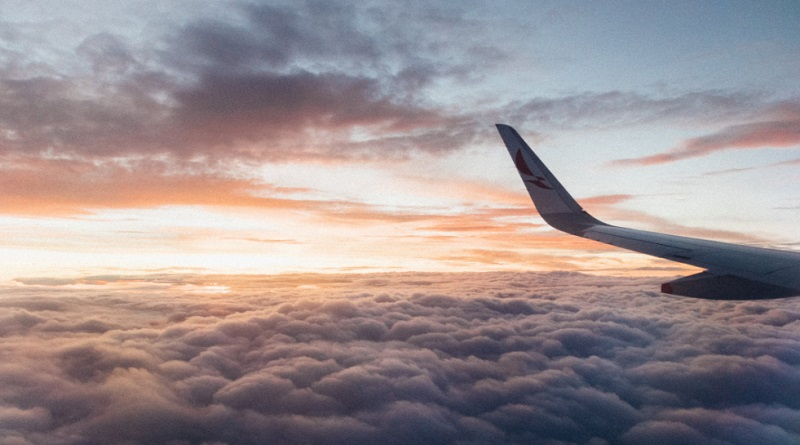 Airplane in sky above the clouds - Combating Travel Anxiety