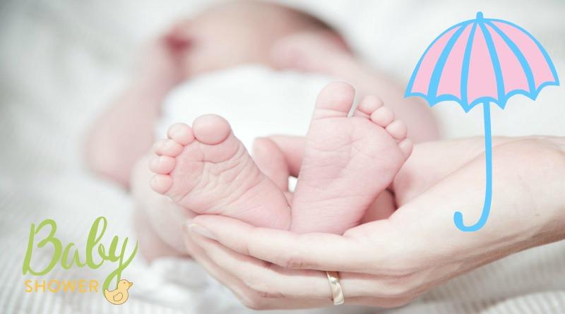 Mother holding newborn baby's feet