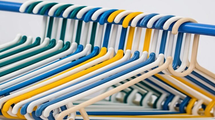 Colorful Plastic Clothes Hangers on Closet Rod - Decluttering and Organizing Your Home