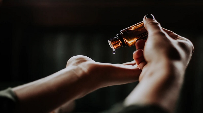 Hand holding small vial of beauty serum - What Does Beauty Mean to You