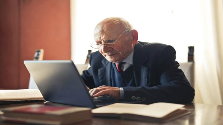 Older Man Working on Laptop - Technology to Have Around When You Get Older