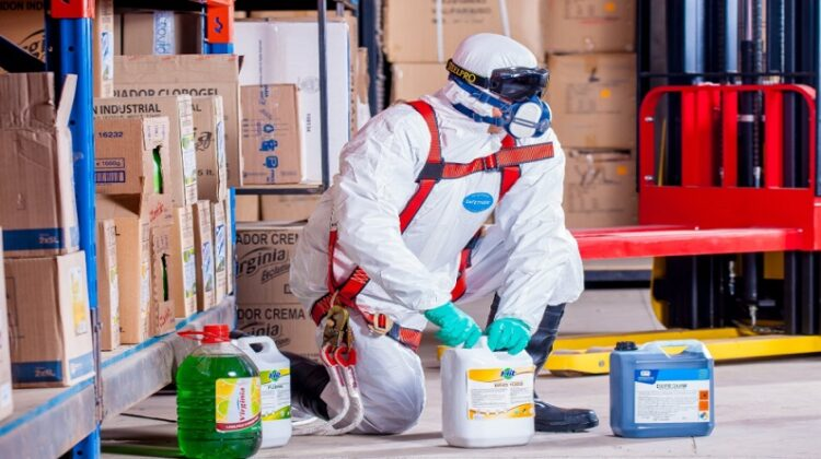 Person in PPE with Chemicals - Spill Response Procedure
