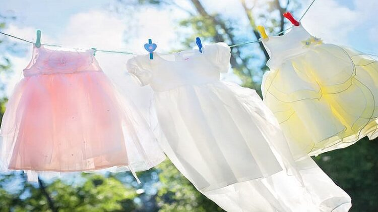 Pretty little dresses hanging on a clothesline - Eco-Friendly Laundry Detergent