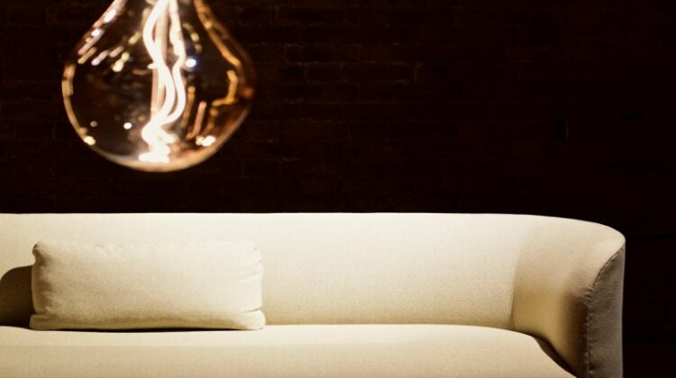 Sleek Sofa beneth contemporary light fixture