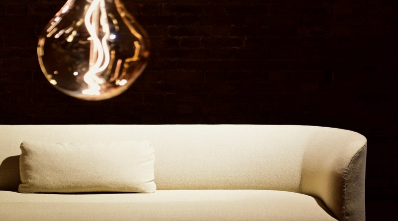 Sleek Sofa beneth contemporary light fixture