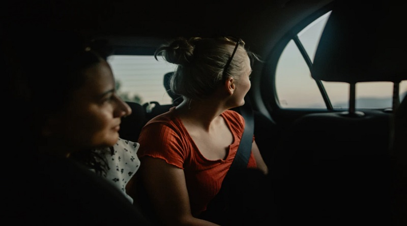Two women in a car -How to Plan the Ultimate Girls Trip