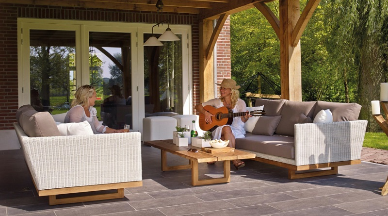Two women in white dressed on patio - Care Tips to Make Your Patio Shine