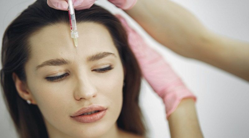 Young Woman with Brunette Hair getting Botox Injection - Botox