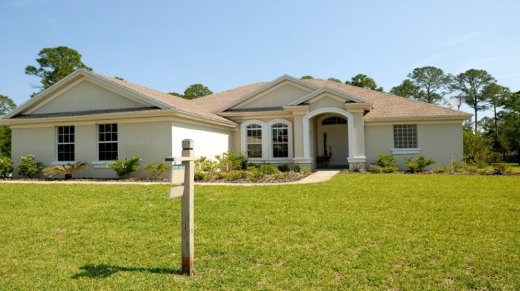 Beige Home with Tan Trim and For Sale Sign in Front Yard -Stressful Things About Owning A House