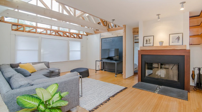Bright Open Living Room with Light and Dark Wood Beams - Home Situations You Never Want To Experience