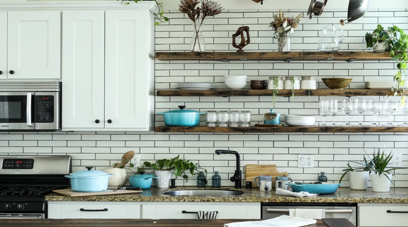Kitchen with white cabinets and tile and open shelving...turquoise accents. -