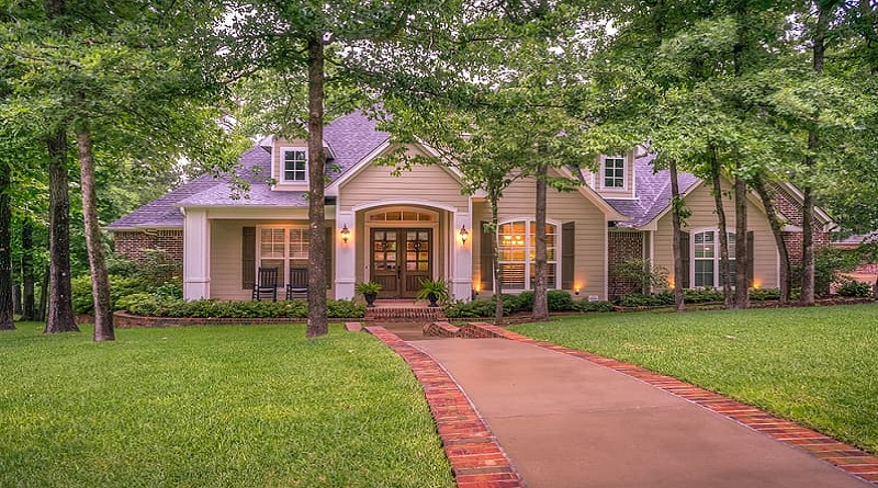 Beautiful Brick Home with Trees and Landscaped Yard
