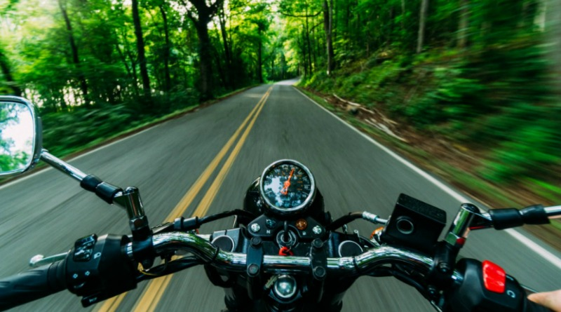 Motorcycle going down beautiful tree lined road - Make Your Motorcycle Safer
