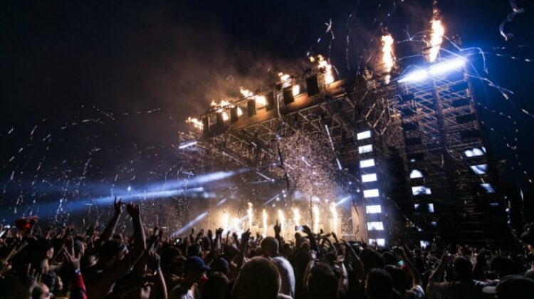 Stage at huge nighttime concert - Nailing The Dress Code For Your Night Out