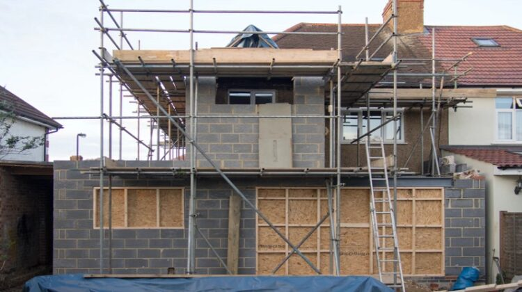 Scaffolding on outside of concrete block building -