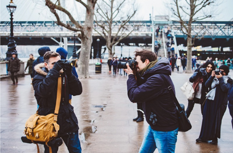 Several Photographers together taking photos together - Best practices to market your freelance photography business