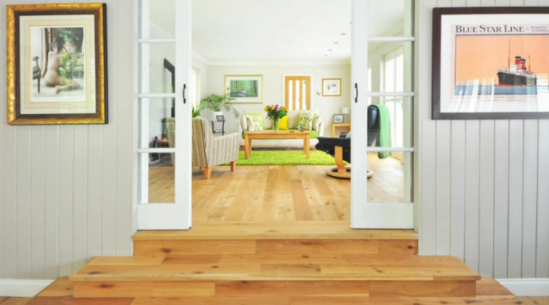 Step Up into Room with White Walls, Wood Floors, and Skirting Boards -