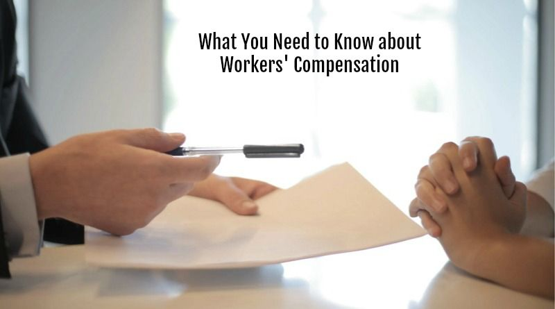 Hands Across Desk with Paper and Pen - Workers' Compensation