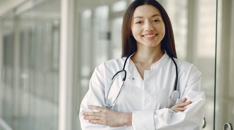 Younge Female Doctor in White Coat - Is Becoming an Otolaryngologist a Good Career