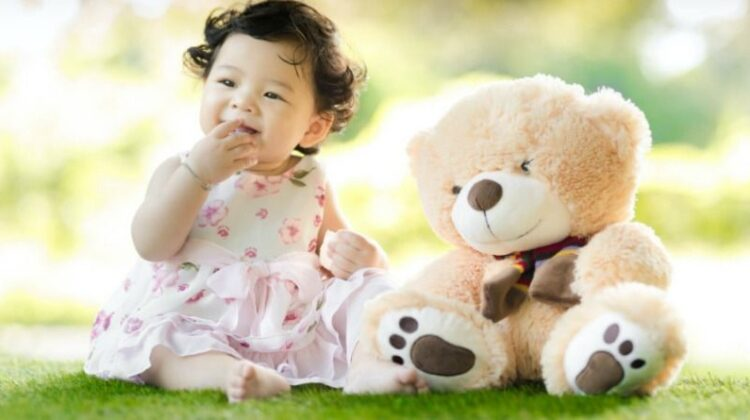 Baby Girl in Floral Dress sitting on Grass with Teddy Bear - baby girl clothes