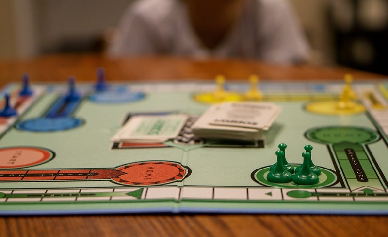 Board Game Sitting on Wooden Table - Fun Activities you Can do on a Rainy Day