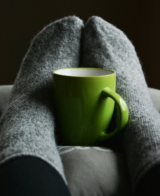 Bright Green Mug Between Stockinged Feet - Winter-Proof Your House