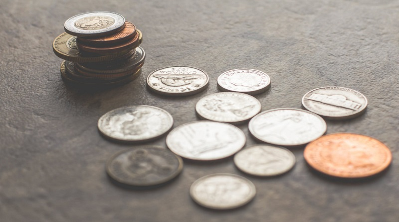 Coins on a table - Are Your Finances Secure