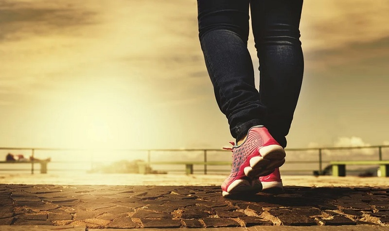 Feet in red shoes walking  - Enhance Your Natural Beauty