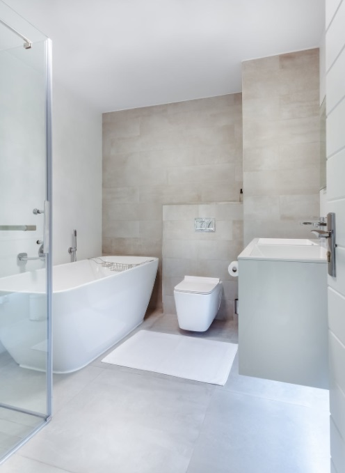 Tiled bathroom with large soaker tub -