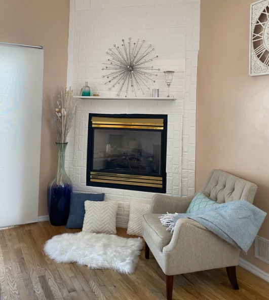 Fluffy White Rug on Wood Floor in Front of Fireplace - Prepping Your Home for the Coming Winter