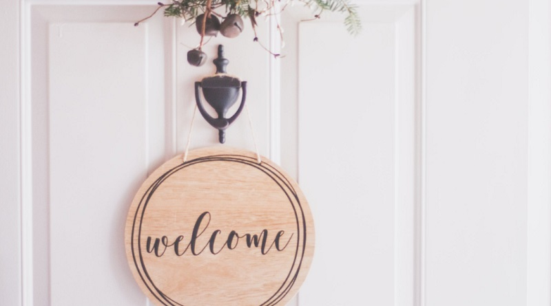 Front Door with Knocker Greenery and Welcome Sign - Beautiful & Inviting Home Entryway
